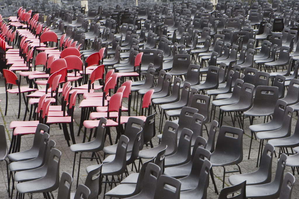All empty chairs in red and black